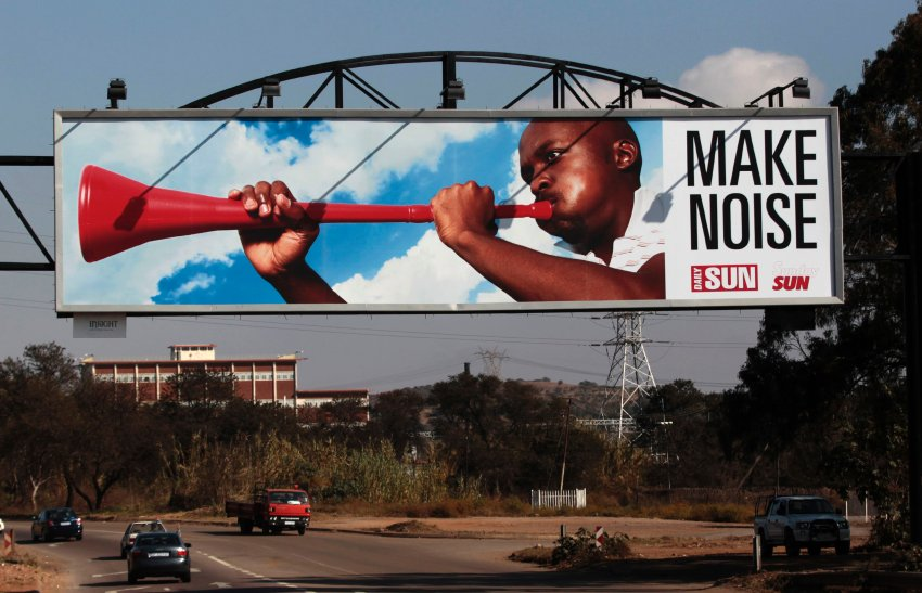 An advertising board with a man blowing a vuvuzela is seen in Pretoria